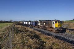 082 on Waterford-Ballina DFDS liner at Cherryville Junction 19-Nov-10 (metrovick) Tags: irishrail iarnrodeireann ie071class ie082 emd emdexportloco jt22cw railroad railway railwaykildare dfdsliner freighttrain containertrain