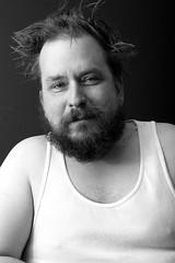 Life's got me down (a3p601) Tags: selfportrait bw hair beard wifebeater messyhair man