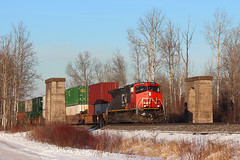 Splitting the Railhenge (view2share) Tags: ic2705 ic illinoiscentral ge generalelectric dash9 locomotive stacks stacktrain doublestack eastbound southbound cn canadiannational cold winter deansauvola wisconsin wi january162017 january2017 january 2017 railway railroading rr railroads railroad rail rails railroaders rring roadtrip train track trains transportation tracks transport trackage trees freight freighttrain rockmont dssa duluthsouthshoreatlantic bridge abandoned abandonment superiorsub northwoods northwood northernwisconsin northwesternwisconsin concrete pier overpass