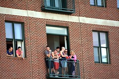 Lots of people watching from the balcony. (kennethkonica) Tags: blue costumes windows red people usa white men brick america fun nikon women midwest random candid indianapolis balcony crowd group indy indiana pride superman comicbookhero indypride nikond7100