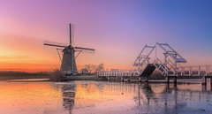 Sunset Museum Mill Nederwaard (rudi.verschoren) Tags: sunset bridge cold water frozen colors nederwaard mill museum kinderdijk location authentic holland ice europe eos europa exposure reflection red blue purple yellow outdoor orange landscape heritage white contrast foot ngc canon 70d