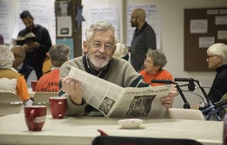 Tom Casey Reads the Catholic Worker Newspaper During Witness Against Torture's Fast Breaking Meal