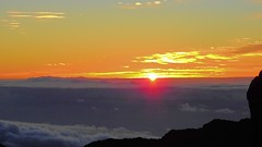 Haleakala Crater Sunrise (Jim Mullhaupt) Tags: sunrise haleakalacrater haleakala volcano 10000ft cold windy maui hawaii island pacificocean pacific statepark sunup dawn sun morning sky clouds color red orange pink yellow blue silhouette weather tropical exotic wallpaper landscape nikon coolpix p900 jimmullhaupt beach southpacific surfing surf vacation holiday travel usa family kids surfers waves boating coral mountains photo flickr geographic picture pictures camera snapshot photography nikoncoolpixp900 nikonp900 coolpixp900