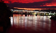 The Calm After the Storm (2) (Roland 22) Tags: reflection lightshow chattanooga tn tennessee tennesseeriver walnutstreetbridge water coolidgepark northshore lamps lights red orange yellow purple blue green white clouds horizon island bluffview flickr