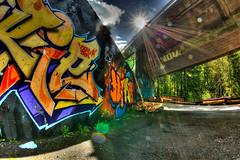 Graffiti Sunrails (Bugtris) Tags: 815f4l flare brücke fisheye abstrakt riggisberg sunflare graffiti canon 5dmkiii sägewerk sunrays