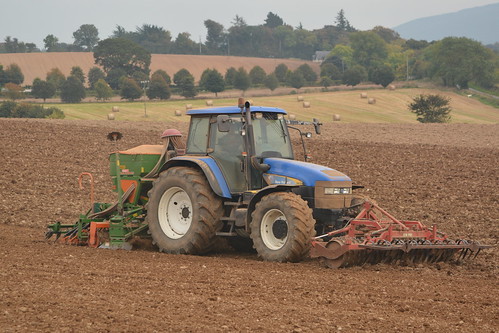 New Holland TM155 Tractor with  a Farm Force Front Press, an Amazone ADP 303 Special Seed Drill & Power Harrow