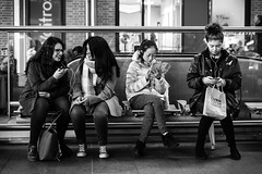 Connected (Cliff.j) Tags: station bench seats candid phones headphones street railway listening music concourse kings cross london girls sony a7 carl zeiss sonnar 55mm mirrorless scene urban group people