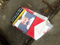 Baby Addict (Quetzalcoatl002) Tags: addict baby warning cigarettes package smoking publichealth street waste closeup marlboro scary ridiculous pavement children fopspeen tobacco comforter pathetic