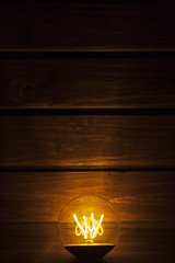 electric background (Antonio MalaMente) Tags: apple background wood lightbulb black bulb idea light edison table lamp incandescent vintage dark wooden bright power electric electricity floor retro filament glow art old space tungsten