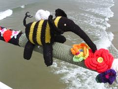 Knitted bee elephant (Nekoglyph) Tags: flowers elephant black beach yellow pier seaside wings sand alice character yorkshire cleveland literature bee lookingglass knitted adventures wonderland sys stripy lewiscarroll saltburn yarnbombing yarnstormers