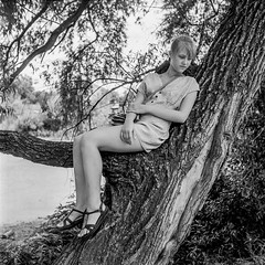 at a lake (Guy Fawkes Jr.) Tags: portrait blackandwhite bw lake tree 6x6 tlr girl analog vintage mediumformat square grain naturallight 120film d76 negative scanned mf recreation rollfilm classiccamera yashica635 selfdevelop classicblackwhite epsonv700 oldschoolphotography yashinon80mmf35 film:iso=100 manualfocuslenses shanghaigp3100 фотопленка developer:brand=kodak developer:name=kodakd76 film:brand=shanghai film:name=shanghaigp3100 sgpff filmdev:recipe=7028