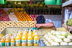 Shopkeeper (Kuba Abramowicz) Tags: philippines asia asian market shop shopping shops shopkeeper people street streets scene man men vegetables color colors colorful colours colour asleep sleep sleeping work working nikon nikkor 35mm d610 boracay island islands