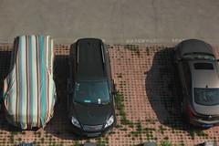 looking down (LolaKatt) Tags: china colour cars horizontal canon outside asia vehicles rows automobiles verticality jinan colourphotography shandongprovince carcovers canonrebelt2i larisakarr