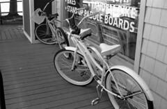 pair of bikes (bergytone) Tags: bw film analog minolta 100 himatic 114 kentmere himatic7s ilfosol3