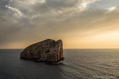 Solitario al tramonto (albepin33) Tags: sardegna sunset sea water rock clouds gold tramonto nuvole mare loneliness outdoor acqua alghero