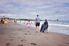 Beach (KiwiMiriam) Tags: beach fitzroy nz newzealand newplymouth taranaki ocean sea waves sky blue clouds sunshine fuji xe2 23mm mirrorless boy girl man boogieboard