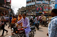 Cross junction in Benares (Sandrine Vivès-Rotger photography) Tags: benares varanasi india crossingtheroad traffic road busy crazy streetphotography colours advertising