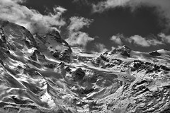 The Klein Matterhorn (3, 883 alt. ) the Breithorn under clouds  , the Theodulgletscher and the Theodul pass. A view from the train to Gornergrat .Zermatt , Switzerland. No. 4208 detail. (Izakigur) Tags: helvetia liberty izakigur flickr feel europe europa dieschweiz ch lasuisse musictomyeyes nikkor nikon suiza suisse suisia schweiz romandie suizo swiss svizzera سويسرا laventuresuisse nikond700 nikkor2470f28 myswitzerland cantonduvalais kantonwallis