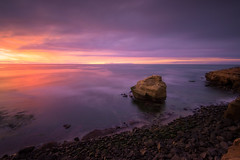 Sunset Cliffs (David Colombo Photography) Tags: sandiego sunset sunsetcliffs seastack california clouds ocean pacific sea water light color vibrant purple yellow orange rocks cliff lowtide nikon d800 davidcolombo davidcolombophotography landscape outdoor longexposure