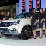 Isuzu mu-x with beautiful presenters at the 33rd Thailand International Motor Expo at IMPACT Challenger hall in Mueang Thong Thani, Nonthaburi thumbnail