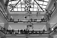 At the mall (Daniel Nebreda Lucea) Tags: mall centro comercial architecture arquitectura building edificio construccion shop shopping tiendas tienda comprar buy sell vender ocio weekend life berlin germany alemania black white blanco negro monochrome monocromo lights luces shadows sombras people gente geommetry geomtria composition composicion perspective perspectiva urban urbano mitte travel viajar look mirar relax lines lineas