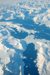 Greenland (FarFlungTravels) Tags: ocean travel blue sea white snow water airplane aerial glacier greenland
