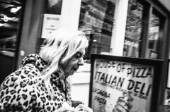 R0044703 (G. L. Brown) Tags: arcade leopardcoat pizza woman nashville streetphotography signage storefront blackandwhite bw