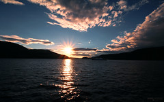 Saguenay River Sunset - Parc National du Fjord du Saguenay (Québec, Canada) (Andrea Moscato) Tags: andreamoscato america canada landscape paesaggio fiume river riflesso reflection sunset sun ray dusk tramonto water freshwater acqua waves mountain montagna silhouette nature natura nuvole natural naturale national np nationalpark parco park sky clouds shadow light blue evening