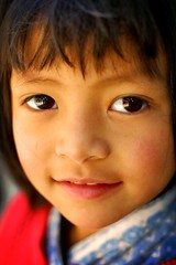 close up portrait (phitar) Tags: travel 2002 nepal portrait girl smile topf50 asia kathmandu phitar