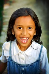 happy girl (phitar) Tags: travel 2002 nepal portrait topf25 girl children happy asia teeth kathmandu phitar