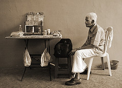 Whistler's Father (pfong) Tags: road old man bird topf25 sepia bag table cards chair singapore waiting sitting indian parrot cage fortune patient plasticbag duotone littleindia fortuneteller patience teller serangoon whitehair foldingtable kdpic1
