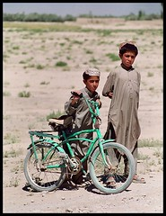 the green bike (janchan) Tags: portrait people afghanistan bike kids children desert documentary ritratto reportage fujisuperia400 ghazni qarabagh blackribbonicon thetaleofaurezu whitetaraproductions