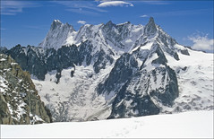 Dent du Geant and Grandes Jorasses (Ron Layters) Tags: france alps nature geotagged slide transparency chamonix hautesavoie pentaxmz10 mountainsalps geo:lat=45873637 geo:lon=6983013 elevation40004500m dentdugeant grandesjorasses altitude4013m altitude4208m ronlayters slidefilmthenscanned massifdumontblanc rochefortridge fishshapedcloud takenfromtheenversduplanglacier summitgrandesjorasses summitdentdugeant