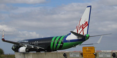 Flying ad (Simon Lieschke) Tags: plane airport ad sydney advertisement virgin 737 73781q vhvoi