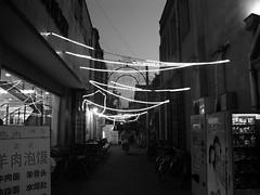 DSC06300 (Matthew Stinson) Tags: china urban blackandwhite lights nightshot sony alleyway motorcycle vendingmachines tianjin dscf828 binjiangdao hepingdistrict