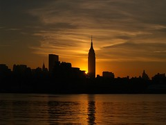 Suns up (pmarella) Tags: 2005 new city nyc newyorkcity morning sky urban usa sun ny newyork color reflection building water skyline backlight night clouds sunrise river landscape fantastic bravo manhattan topc serenity whatever viewlarge nyskyline metropolis hudsonriver empirestate e300 natureslight mireasrealm citybelt riverviewpkproductions