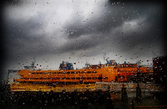 Ferry Rain (adrianadesigner) Tags: nyc orange cloud deleteme9 window water glass rain nycpb yellow ferry photoshop island grey boat drops interestingness lomo savedbythedeletemegroup vibrant adriana saveme10 statenisland stgeorge fakelomo staten adrianadesigner hudsonharbor