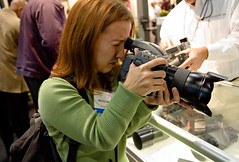 Rachel and $30K of camera. (Ryan Brenizer) Tags: 2005 camera nyc newyorkcity woman newyork green rachel nikon october photographer emotion manhattan candid d70s noflash redhead hasselblad 1755mmf28g unposed photoexpo h2d