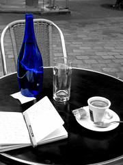 Montmartre (John Althouse Cohen) Tags: blue bw paris france feet moleskine coffee caf pen photoshop cutout table bottle cafe chair notes awesome inanimate montmartre bleu madeleine linked uniball moleskin stylo cahier verredeau johncohenphotos