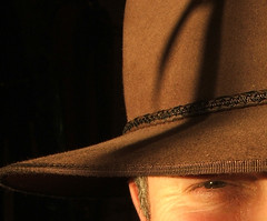Dan from Tirau, New Zealand (Catching Magic) Tags: newzealand portrait people selfportrait hat topv111 interestingness cool oz topc50 country australian topv222 minimal waikato tiraudan tirau glint stockman topten akubra mc05 mc05negativespace topinterestingness topten0405 topvaa topmc05
