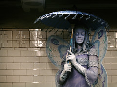 subway fairy ((michelle)) Tags: nyc blue people umbrella subway costume wings bc purple manhattan performance fairy parasol fv10 busker unionsquare performer busking faerie livingstatue michellesshowcase