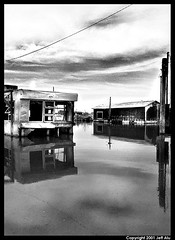 Submerge (Jeff T. Alu) Tags: black white photoshop digital water flood trailer decay surreal moody lonely dark outdoors bleak blackandwhite deserted illusion zen medetation medetate power impact graphic doom bright earthy dirt gritty intense visionary heat passion 4x4 remote california desolate dreamy nightmare euphoric