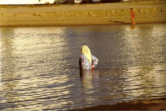 strange swimmer (omnia_mutantur) Tags: woman beach water girl lady swimming donna mujer eau veil femme muslim islam mulher egypt hijab bust half swimmer acqua bagno bathingsuit egitto ragazza agia urghada redsee