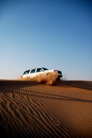 arabian desert safari sand dunes gmc truck dubai