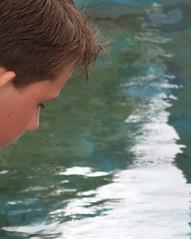 Thoughts (Catching Magic) Tags: portrait boy mc05negativespace mc05 face water vortex pool pond tiraudan original olympus e300