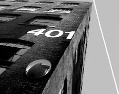 flight 401 (bw) (Mr.  Mark) Tags: city bw white toronto black reflection building lamp monochrome plane mirror saveme3 deleteme10 smoke perspective number 401 11122005 flickrchallengegroup markboucher