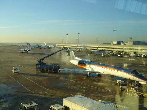 BD Embraer 145 being de-iced at MAN