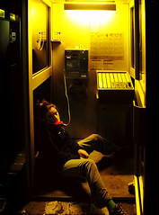 hanging on the telephone (-Antoine-) Tags: camping light yellow night jaune booth switzerland solitude sitting loneliness phone suisse lumire telephone lausanne sit poet lonely vidy svizzera veronique nuit vero vronique assis gaston seule seul vro cabine posie tlphone miron assise poete pote gastonmiron antoinerouleau