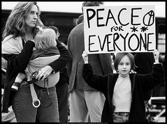 Peace for Everyone (danny.hammontree) Tags: 2005 blackandwhite bw woman art girl children nikon war peace child unitedstates florida miami georgebush politics rally protest january photojournalism antiwar antibush d100 nikkor vigil marches rallies hammontree digitalgrace 70200mmf28gvr dannyhammontree wwwdigitalgracecom