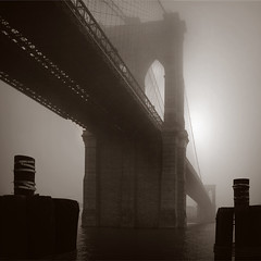 Bridge and sentinels in fog (gaspi *yg) Tags: street nyc newyorkcity bridge urban blackandwhite bw newyork topf25 fog photoshop topf50 nycexpo 2006 brooklynbridge duotone pilings tinted a2 sentinels gaspi 1in10f100v 1in10f200v 1in10f50v renderlighting sr162 1in10300v